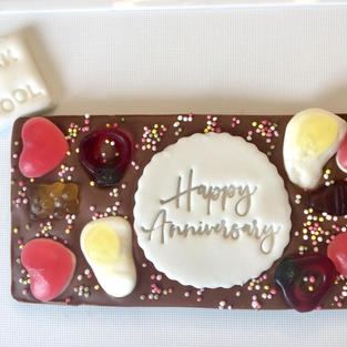 £4.50 Belgian milk chocolate topped with a topping of your choice from my other bars plus stamped icing - just let me know your message/celebration.