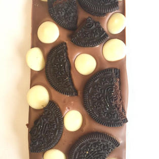 £4.50 Belgian milk chocolate topped with chocolate flavour sandwich biscuits with a flavoured filling and white chocolate buttons
