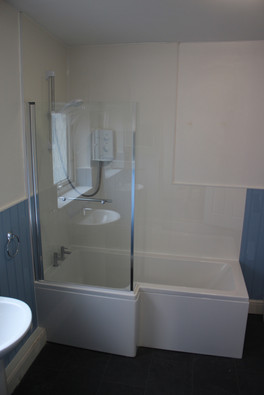 Relax in our lovely big new bathroom.