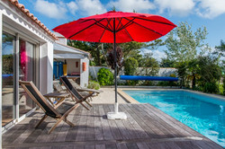 pool, hammock and beach umbrellas