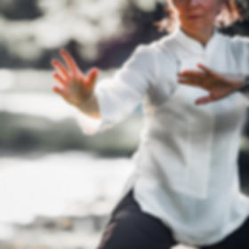 Woman practicing Tai Chi Quan in the par