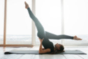 Young beautiful woman practicing yoga an