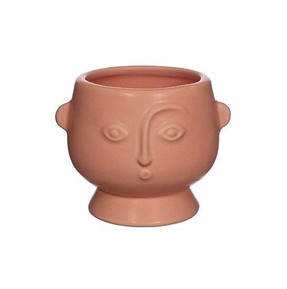 Pot plante visage abstrait rose doux