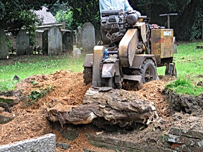 Digger removing the tree stump at School Hill cemetary