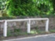 Old white rails around church