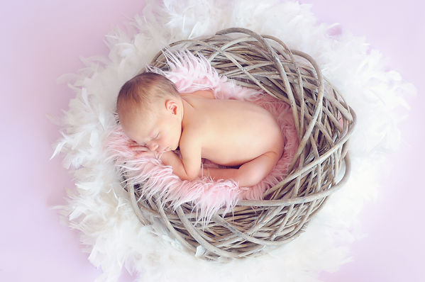 baby-sleeping-in-a-basket-and-a-round-fe