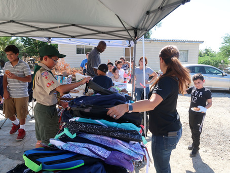 Boy Scout Donates 65 Backpacks to Children at Shady Lane Mobile Homes