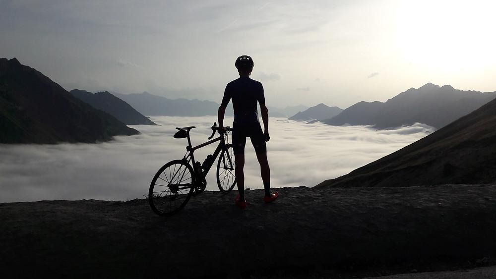 Road cycling, mountain top, peaks, blanket of cloud