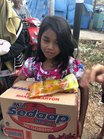 This little sweetheart was camped outside after her family's house was too damaged and dangerous to live in.  They had very little food so this big box was a gift from TUF Minds – Life Rescue to take to her Village.  Thanks to all who donated money for Dr Eli to buy these much needed items.  Yours in Positivity Dr Eli McIntosh