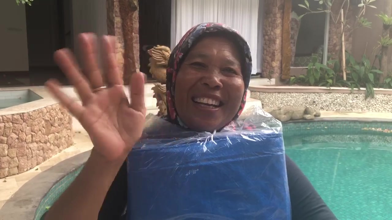 This is Annie her house crumbled around her and her children, the first earth quake in Lombok and the second one finished it off. They were sleeping on the ground and all getting soaked when it rained with no shelter. She was so excited to take to her children this big tarp that they can shelter under. The next day I saw her she said it was BAGUS SUkAly (really good) it rained, and her children didn't get wet and cold. Thanks to TUF MINDS -LIFE RESCUE and all who donated money for Dr Eli to buy stuff with. Yours in Positivity Dr Eli McIntosh