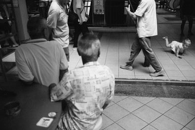 Scene from a hawker center during a family photoshoot