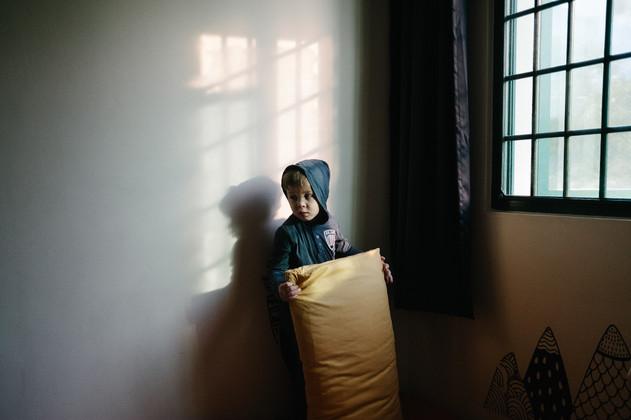 Portrait of child in his bedroom