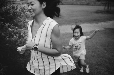 Mother and daughter chasing each other