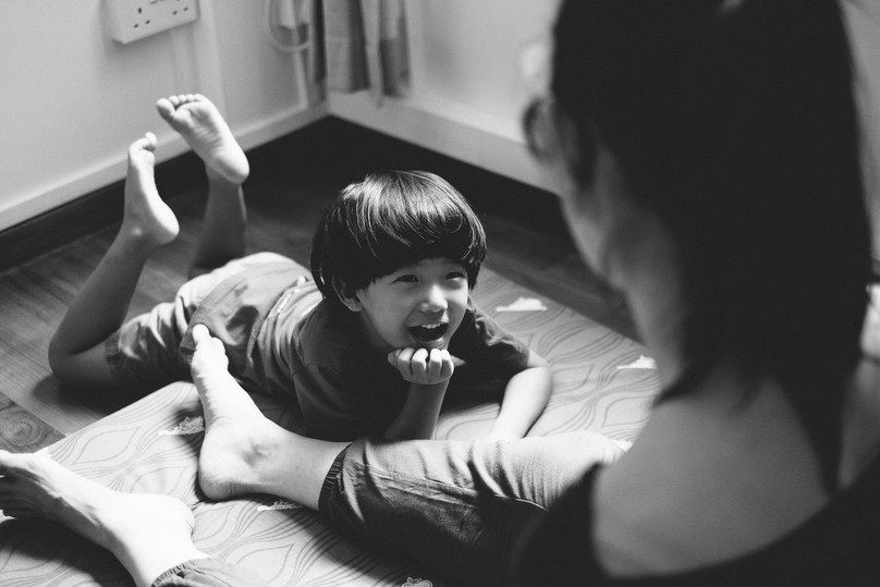 A child listening to his mother