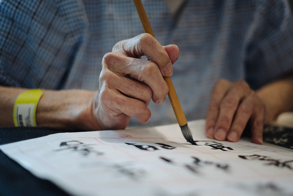 Hospice patient writing chinese calligraphy