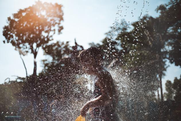 Water splashes on girl