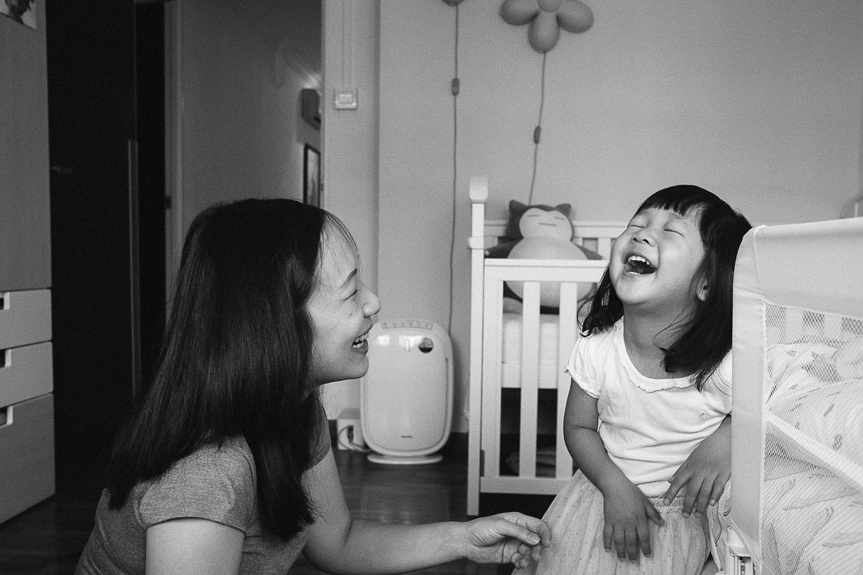 Mother and daughter sharing a funny moment.