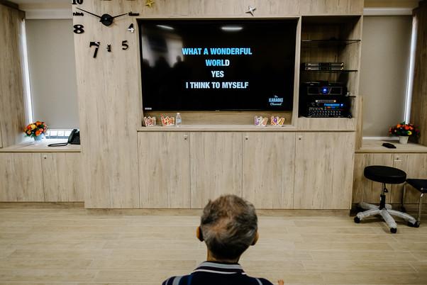 Hospice patient watching karaoke