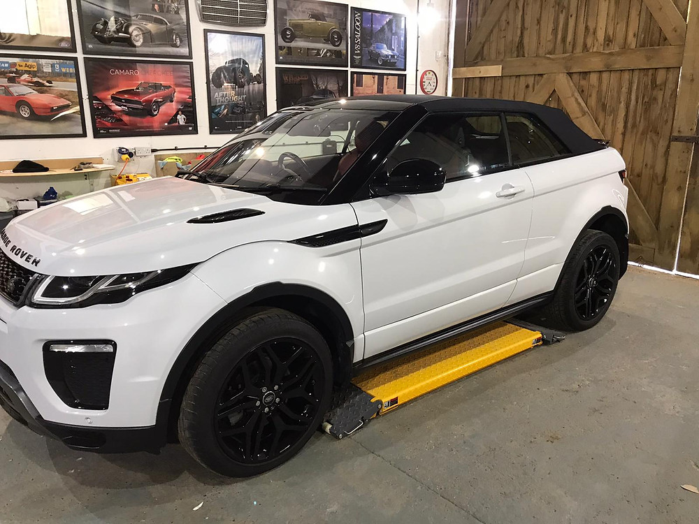 RANGE ROVER EVOQUE had a full decontamination machine polish and a SB3 OMEGA CERAMIC COATING and the fabric hood had an application of SB3 FIBRE.