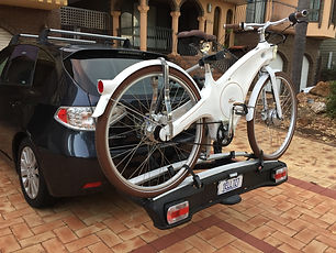 The Tiller Rides Roadster e-bike on a car bike carrier