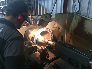 Sean machining part of the Tiller Rides Roadster electric bike in our Fremantle workshop