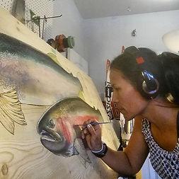 Mimi Matsuda painting a steelhead couple, Bozeman, MT.