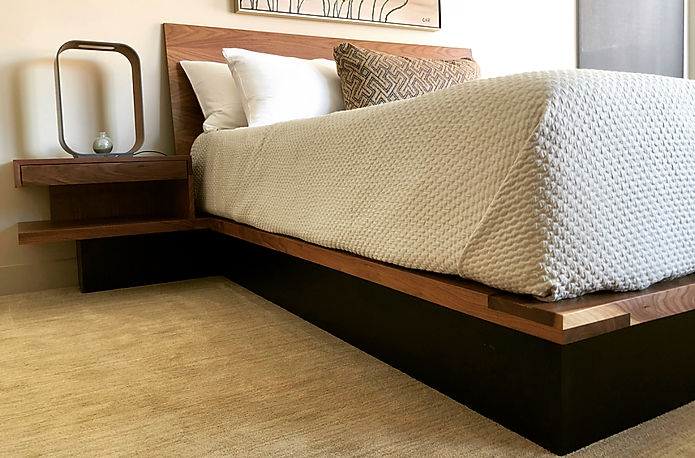Walnut bed with floating night stands