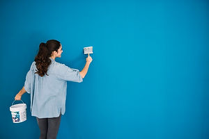woman-painting-blue-wall_23-2147703569.j