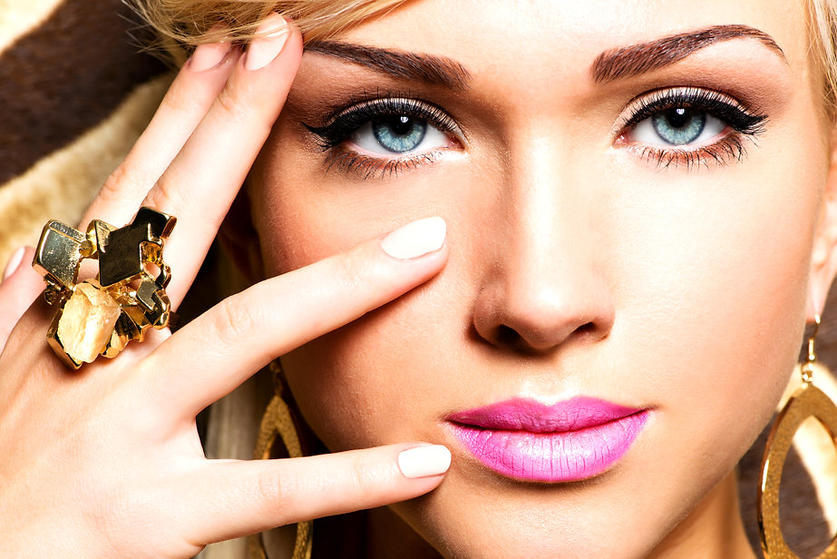 closeup-portrait-beautiful-face-sexy-woman-with-fashion-makeup-gold-ring-finger (1).jpg