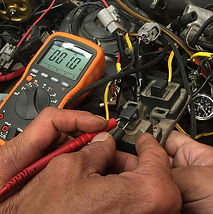 Automotive multimeter being used to test vehicle sensors and actuators.
