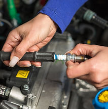 Removing a spark plug for testing a vehicle electronic ignition system.