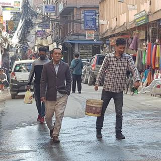 Watering dusty street. Kathmandu