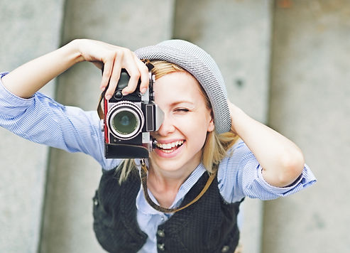 Girl with camera Taking a Photo