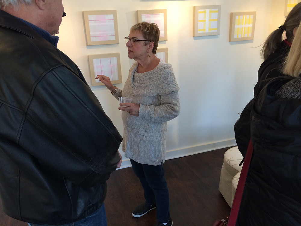 Eveline discussing her work with guests.