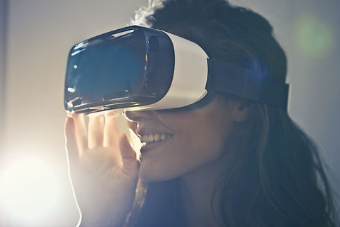 man-wearing-white-virtual-reality-goggle