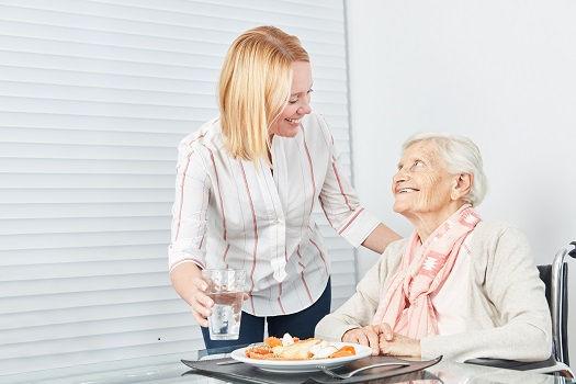 Caregiver-Feeding-a-Senior.jpg