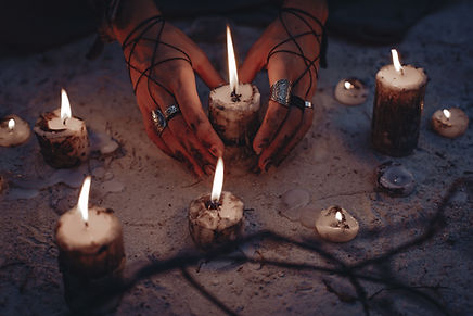 woman hands holding candle close up.jpg