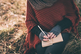 Woman writing in the notebook.jpg