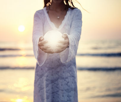 Close up moon in woman's hands sunset on