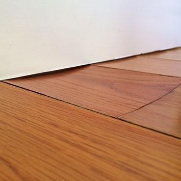 Water-Damaged-Wood-Floors.jpg