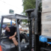 Labor Staff operating Forklift at the Taste of Chicago unloading a pallet of Ocean Spray Juice.