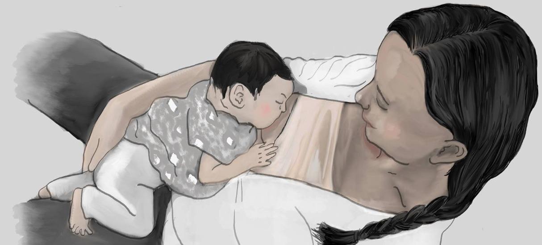 laid back breastfeeding mother
