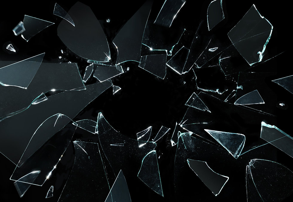 Shattered and broken glass pieces isolat