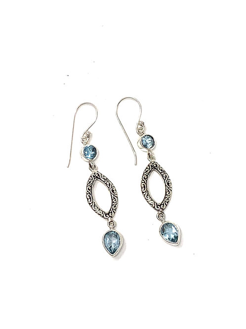 Sterling Silver Dangling Earrings with Natural Faceted Blue Topaz.