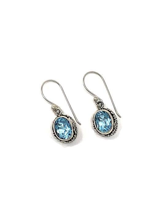 Sterling Silver Oval Dangling Earrings with Natural Oval Faceted Blue Topaz.