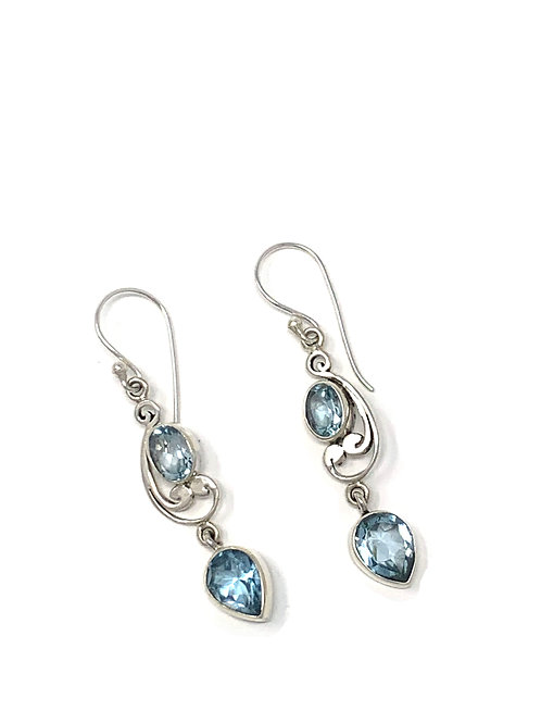 Sterling Silver Dangling Earrings with Natural Oval Faceted Blue Topaz.