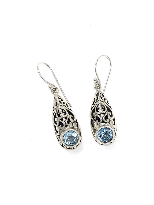 Sterling Silver Pear Shape Dangling Earrings with Faceted Blue Topaz.