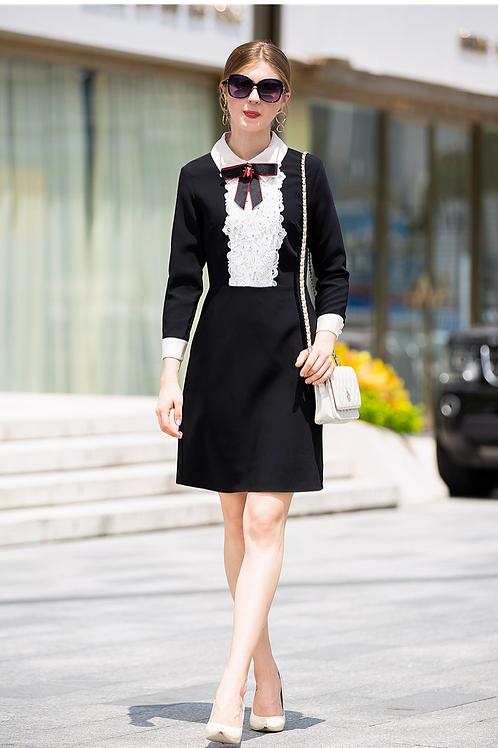 Black sheath dress with lace detail