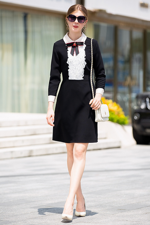 Black and white shift dress with bow detail