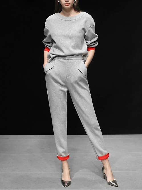 Grey track suit with red trim detail